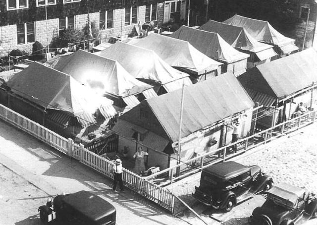 Past tents of the Rockaways, at Beach 98 Street and the boardwalk,late 1930's.